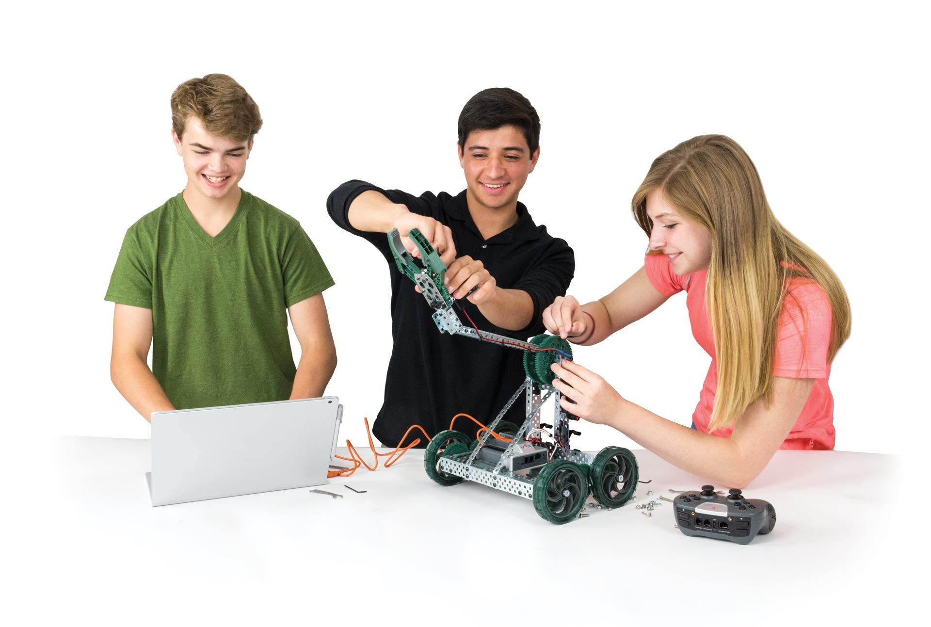 Students building educational robotics kit
